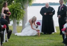 bride at the alter petting her pup