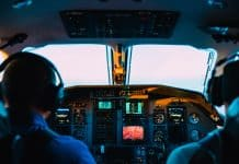 plane cockpit with 2 men