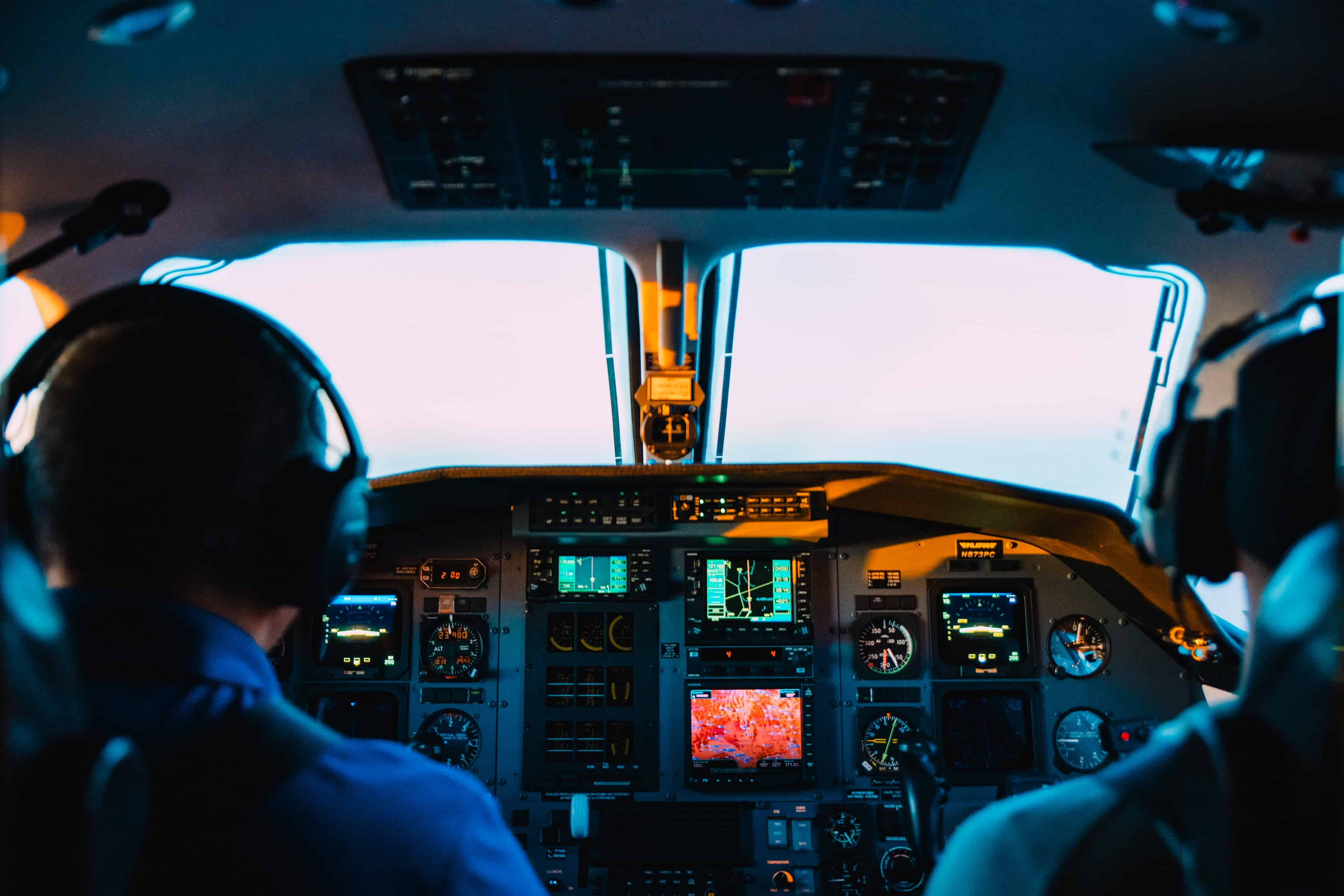 plane cockpit with 2 men
